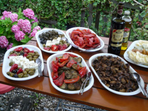 Photo of al fresco appetizers like olives and cheese