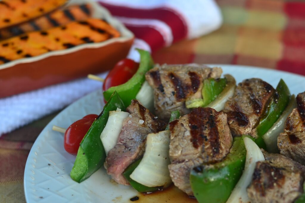 meat skewers and grilled vegetables