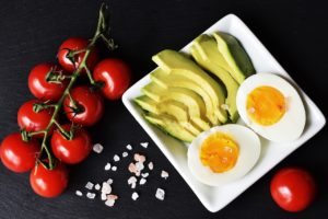 photo of tomatoes, sliced avocado and hard cooked egg