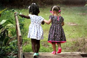 Two littles girs walking together