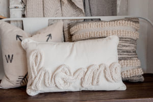 photo of a pillow that says HOME