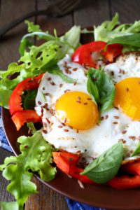 photo of fried eggs with vegetables for breakfast