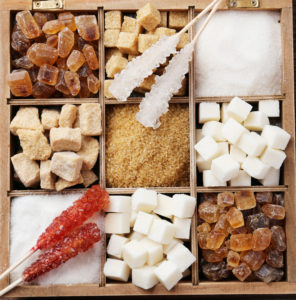 Different types of sugar in a wooden box