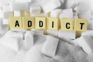 The word ADDICT spelled out in tiles