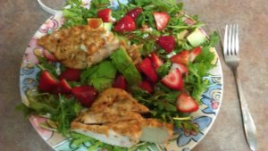 Arugula aka leafy greens, grilled chicken, sliced strawberries, avocado