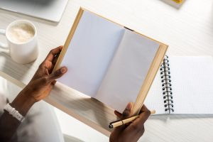 Holding A Journal